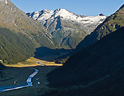 From a small airplane we see Siberia Valley enclosed by snowy peaks in Mount Aspiring National Park in the Southern Alps, South Island, New Zealand. In 1990, UNESCO honored Te Wahipounamu - South West New Zealand as a World Heritage Area.
