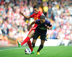 LIVERPOOL, ENGLAND - Sunday September 2, 2012: Liverpool's new loan signing from Real Madrid Nuri Sahin in action against Arsenal's Alex Oxlade-Chamberlain during the Premiership match at Anfield. (Pic by David Rawcliffe/Propaganda)