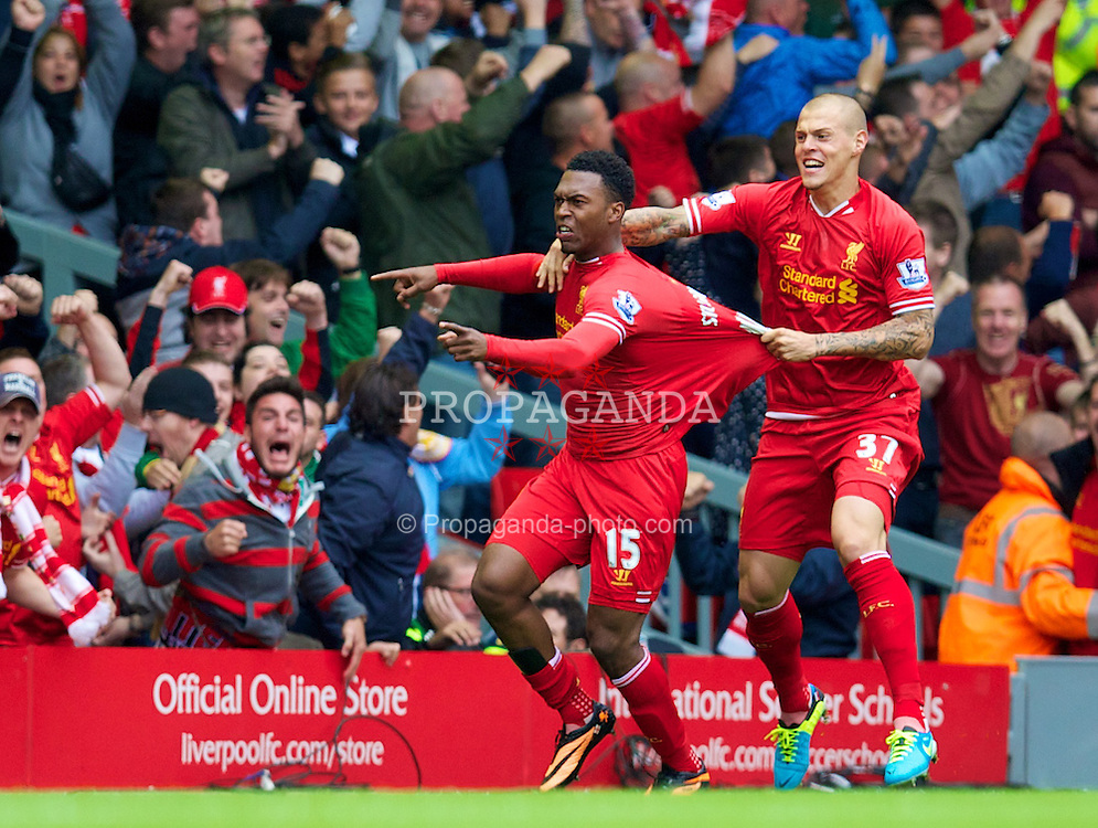 LIVERPOOL, ENGLAND - Sunday, September 1, 2013: Liverpool's Daniel Sturridge celebrates scoring the first goal against Manchester United during the Premiership match at Anfield. (Pic by David Rawcliffe/Propaganda)
