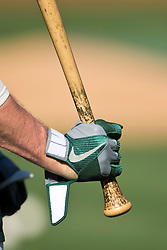 OAKLAND, CA - JULY 25: Detailed view of a Nike batting glove and baseball bat held by Eric Sogard #28 of the Oakland Athletics before the game against the Los Angeles Angels of Anaheim at O.co Coliseum on July 25, 2013 in Oakland, California. The Los Angeles Angels of Anaheim defeated the Oakland Athletics 8-3. (Photo by Jason O. Watson/Getty Images) *** Local Caption *** Eric Sogard