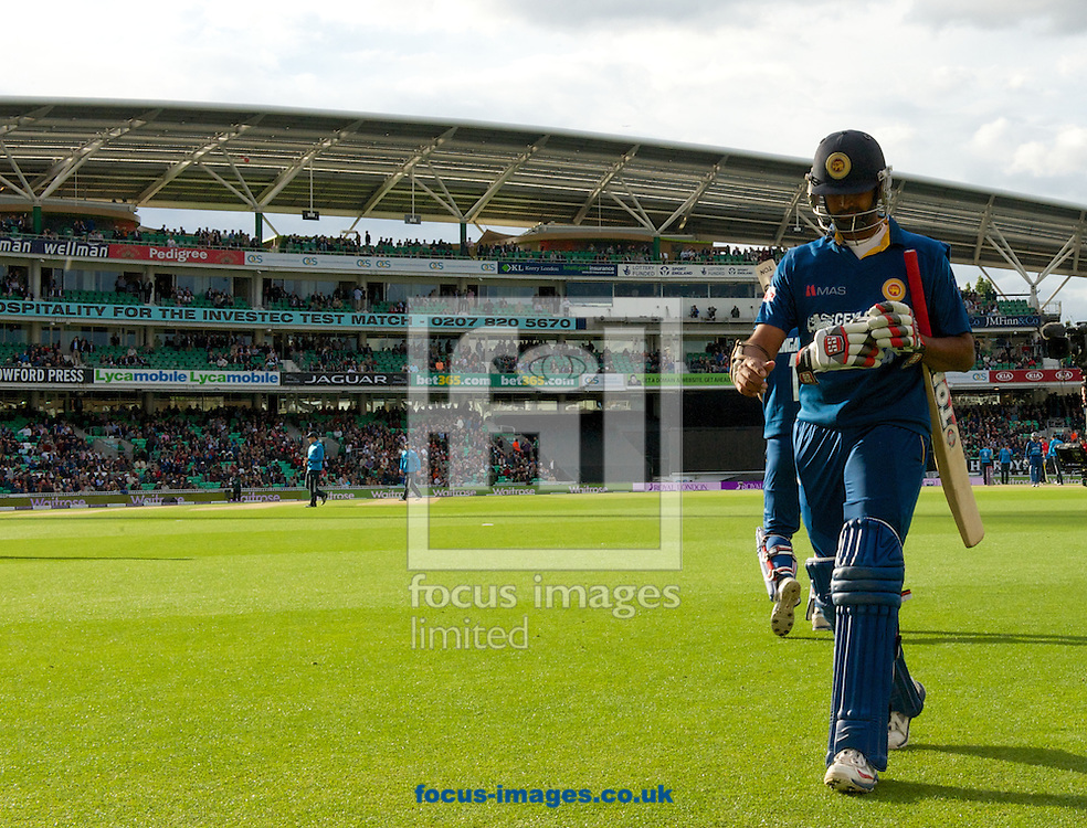 Lahiru Thirimanne of Sri Lanka leaves the field after LBW for a duck during the Royal London One Day Series match at the Kia Oval, London<br /> Picture by Alan Stanford/Focus Images Ltd +44 7915 056117<br /> 22/05/2014