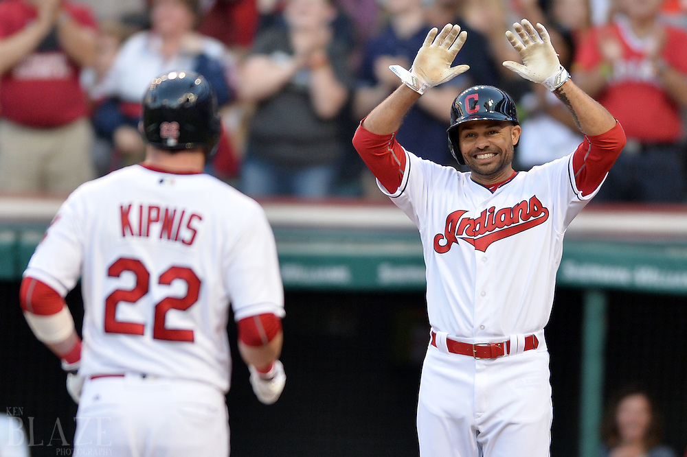 Sep 3, 2016; Cleveland, OH, USA; Cleveland Indians designated hitter Coco Crisp (4) waits to congratulate second baseman Jason Kipnis (22) after Kipnis hit a home run during the first inning against the Miami Marlins at Progressive Field. Mandatory Credit: Ken Blaze-USA TODAY Sports