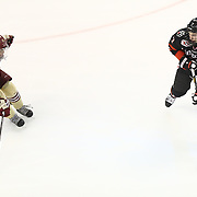 Mike McMurtry #7 of the Northeastern Huskies keeps the puck from Quinn Smith #27 of the Boston College Eagles during The Beanpot Championship Game at TD Garden on February 10, 2014 in Boston, Massachusetts. (Photo by Elan Kawesch)