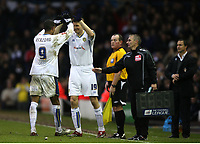 Photo: Paul Greenwood/Sportsbeat Images.<br />Leeds United v Huddersfield Town. Coca Cola League 1. 08/12/2007.<br />Leeds Uniteds Substitute Tore Andre Flo (R) congratulates Jermain Beckford as he leaves the field