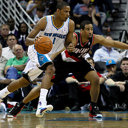 March 30, 2011; New Orleans, LA, USA; New Orleans Hornets small forward Trevor Ariza (1) drives past Portland Trail Blazers point guard Andre Miller (24) during the third quarter at the New Orleans Arena. The Hornets defeated the Trail Blazers 95-91.   Mandatory Credit: Derick E. Hingle