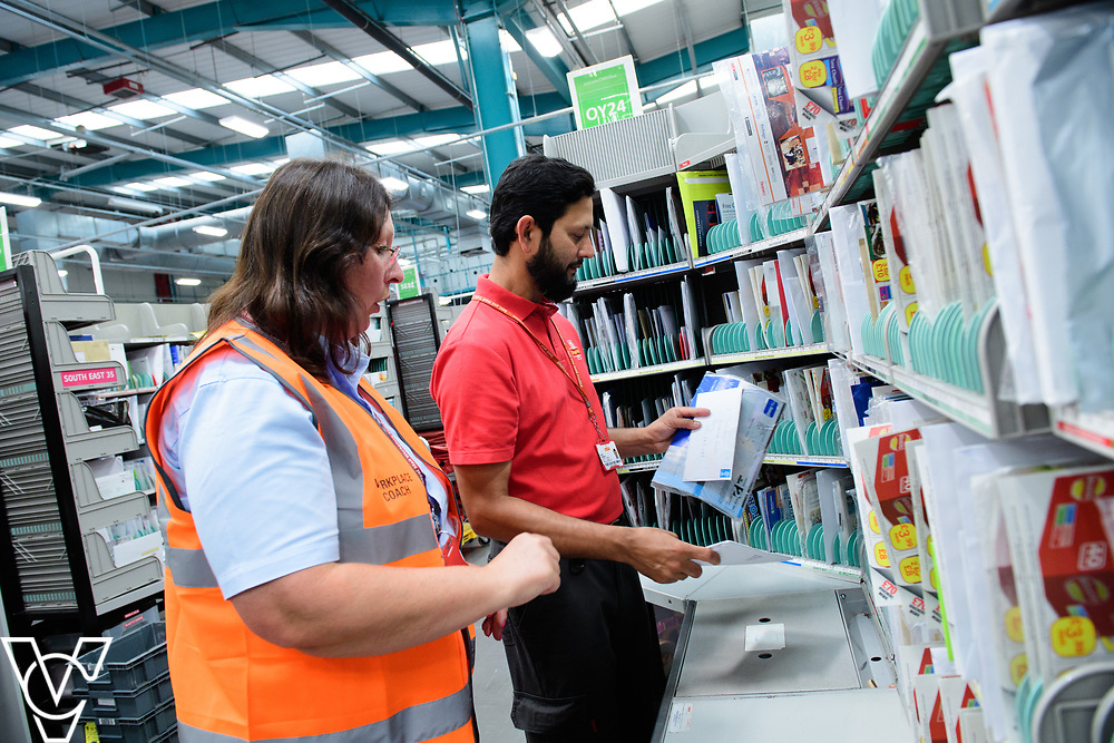 Two delivery offices, Oadby and Leicester South, which are both based inside the Leicester Mail Processing Unit building, have passed the penultimate gateway of One Plan.  One Plan is a business programme designed to have a standardised operation of excellence.  Pictured is Shuaib Chowdhury working with workplace coach Pearl Howard.<br /> <br /> Picture: Chris Vaughan Photography<br /> Date: July 7, 2017