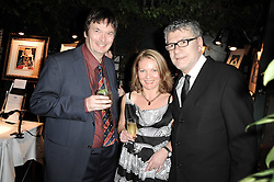 Left to right, writer IAN RANKIN, NATHALIE MARTIN and artist JACK VETTRIANO at the Johnnie Walker Blue Label great Scot Award 2010 in association with The Spectator and Boisdale held at Boisdale of Belgravia, 22 Ecclestone Street, London SW1 on 24th February 2010.