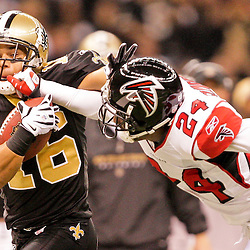 2008 December, 07: New Orleans Saints wide receiver Lance Moore (16) is forced out of bounds by Atlanta Falcons cornerback Domonique Foxworth (24) during the first half of a game between NFC South divisional rivals the Atlanta Falcons and the New Orleans Saints at the Louisiana Superdome in New Orleans, LA.