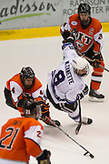 2012/03/16 - RIT's Chris Haltigin (top) and Mike Colavecchia get the puck away from Niagara's Marc Zanette during the Atlantic Hockey semifinal at the Blue Cross Arena in Rochester, N.Y. on March 16th, 2012. RIT defeated Niagara 2-1 in overtime.