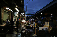Workers handle fish at the Fulton Fish Market in New York November 10, 2005. After more than 170 years of operation, the Fulton Fish Market is scheduled to move to a new indoor facility the Bronx by the end of the week