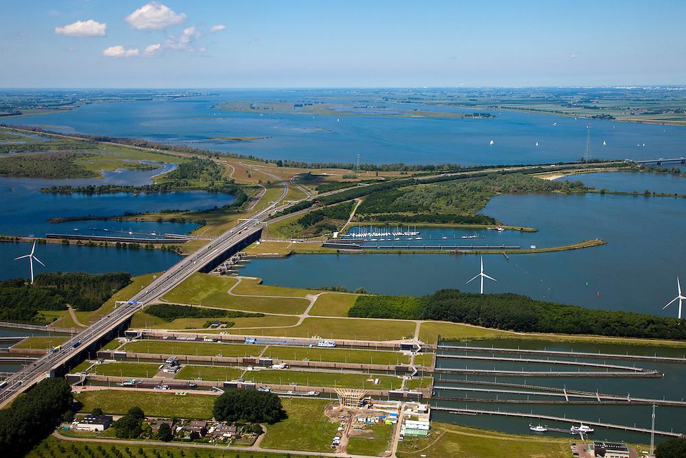 Nederland, Noord-Brabant, Willemstad, 12-06-2009; Volkeraksluizen, de schutsluizen gezien naar het Hellegatsplein. De Volkeraksluizen - in de Volkerakdam - verbinden het Hollandsch Diep met het Volkerak en Haringvliet. Het Hellegatsplein, kunstmatig eiland aangelegd voor het verkeersknooppunt Hellegatsplein tussen de N59 en de A29 (rechtsonder en rechtsboven met Haringvlietbrug). Het eiland ligt in het Hellegat, de driesprong waar Haringvliet, Volkerak en Hollandsch Diep (rechtsboven) samenkomen.Volkeraksluizen, in the foreground three locks..luchtfoto (toeslag), aerial photo (additional fee required).foto/photo Siebe Swart