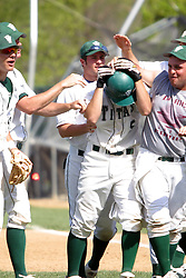 22 April 2006:  ....Pat Cinquegrani takes a beating after scoring in the bottom of the 9th inning to put the game in the books for the Titans.....In CCIW, Division 3 action, the Titans of Illinois Wesleyan capped the Auggies of Augustana College by a scor of 3-2 in game one of a double card afternoon.  Games were held at Jack Horenberger field on the campus of Illinois Wesleyan University in Bloomington, Illinois