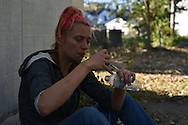 After injecting her arm with heroin, Tara--a mother of five who did not want her last name used--tries to get the cap back onto the syringe, but keeps missing, stabbing herself six or seven times. In the first moments after she shoots up, she says she is numb, but after that, she becomes increasingly erratic.
