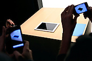 iPhones in tow, fans and media photograph the recently announced iPad 2 following the unveiling in San Francisco on March 2, 2011.