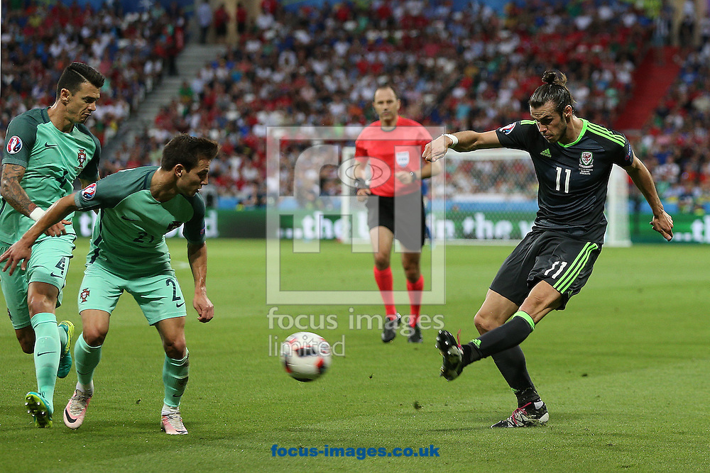 Gareth Bale of Wales crosses the ball during the UEFA Euro 2016 semi-final match at Stade de Lyons, Lyons<br /> Picture by Paul Chesterton/Focus Images Ltd +44 7904 640267<br /> 06/07/2016
