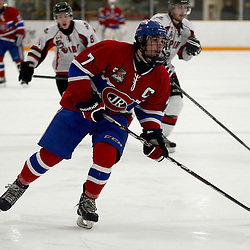 STOUFFVILLE, ON - Jan 2 : Ontario Junior Hockey League Game Action between the Stouffville Spirit Hockey Club and the Toronto Junior Canadians Hockey Club.  Mark Spadafora #7 of the Toronto Canadiens Hockey Club skates after the puck during third period game action.<br /> (Photo by Michael DiCarlo / OJHL Images)