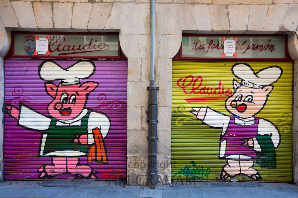 Shop fronts of butchers shop with shutters drawn in Bilbao, Basque country, Spain