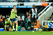 Jetro Willems (#15) of Newcastle United dribbles the ball into the Bournemouth half of the pitch during the Premier League match between Newcastle United and Bournemouth at St. James's Park, Newcastle, England on 9 November 2019.