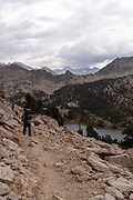 High angle view of backpackers above Charlotte Lake; John Muir Trail/Pacific Crest Trail; Sequoia Kings Canyon Wilderness; Kings Canyon National Park; Sierra Nevada Mountains, California, USA.