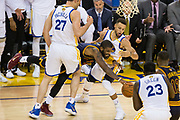 Cleveland Cavaliers guard Kyrie Irving (2) tries to split Golden State Warriors center Zaza Pachulia (27) and Golden State Warriors guard Stephen Curry (30) during Game 1 of the NBA Finals at Oracle Arena in Oakland, Calif., on June 1, 2017. (Stan Olszewski/Special to S.F. Examiner)