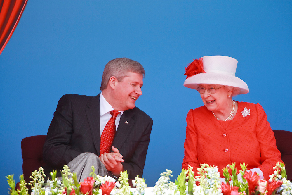 Queen Elizabeth II shares a laugh with Canadian Prime Minister Stephen Harper during Canada Day celebrations on Parlaiment Hill in Ottawa, Ontario, July 1, 2010. The Queen is on a 9 day visit to Canada. <br /> AFP/GEOFF ROBINS/STR