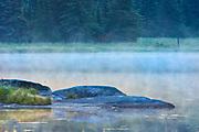 Rocks in Isabel Lake in fog<br />Kenora<br />Ontario<br />Canada
