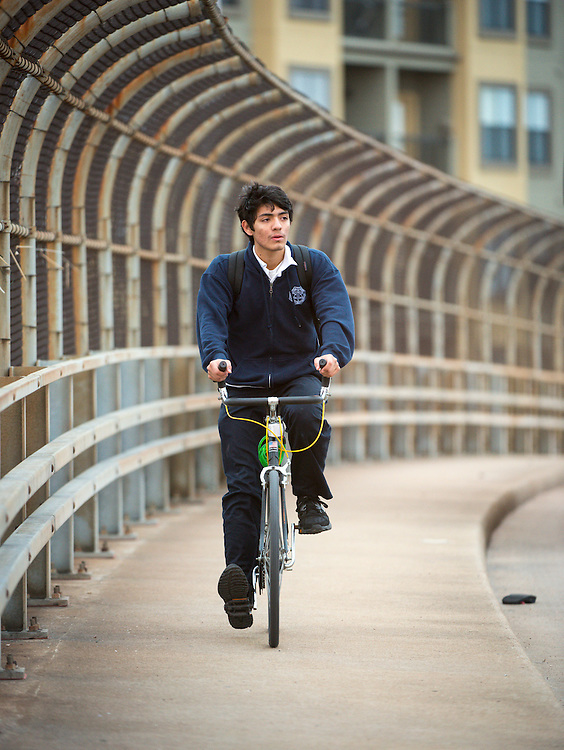 Edgar Avina rides his bicycle to DeBakey High School for Health Professionals, January 30, 2014.