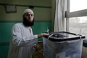 A conservative Egyptian salafi casts his vote during the second day of the historic democratic Presidential election May 24, 2012 in the Imbaba district of Cairo Egypt. The results of the election will help determine to what extent religion will play a role in politics throughout the country. (Photo by Scott Nelson)