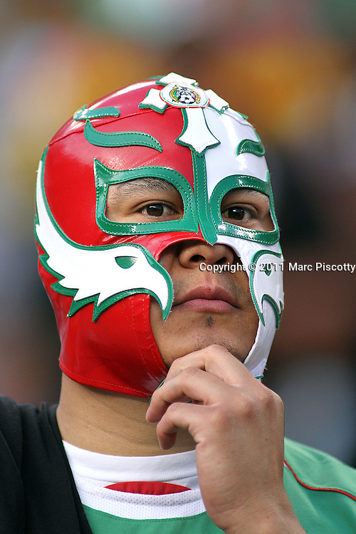 SHOT 6/1/11 7:55:55 PM - A Mexican soccer fan displays his pride via a luchador mask as his team plays New Zealand during their friendly as part of the 2011 FMF U.S. Tour at Invesco Field in Denver, Co. Mexico won the match 3-0. (Photo by Marc Piscotty / © 2011)