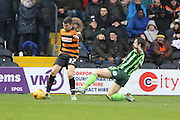 Jon Meades of AFC Wimbledon attempts to stop James Pearson of Barnet FC crossing the ball during the Sky Bet League 2 match between Barnet and AFC Wimbledon at Underhill Stadium, London, England on 20 February 2016. Photo by Stuart Butcher.