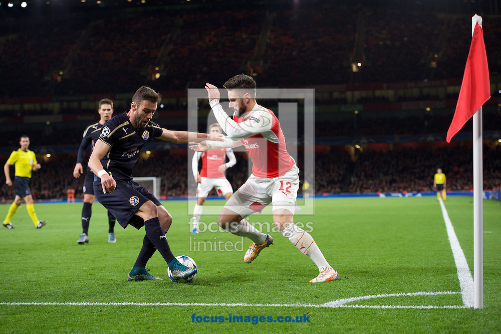 Olivier Giroud of Arsenal takes on Ivo Pinto of Dinamo Zagreb during the UEFA Champions League match at the Emirates Stadium, London<br /> Picture by Alan Stanford/Focus Images Ltd +44 7915 056117<br /> 24/11/2015