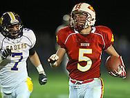 Marion's Tyler Gunderson (5) tries to outrun Central DeWitt's Jacob Kagemann (7) during their second round playoff football game at Thomas Park Field in Marion on Monday, October 29, 2012.