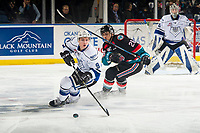KELOWNA, CANADA - NOVEMBER 23:  Leif Mattson #28 of the Kelowna Rockets back checks Matthew Smith #9 of the Victoria Royals as he skates with the puck on November 23, 2018 at Prospera Place in Kelowna, British Columbia, Canada.  (Photo by Marissa Baecker/Shoot the Breeze)