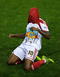 """Bristol City Midfielder Jay Emmanuel-Thomas (ENG) celebrates scoring a goal by revealing a tshirt that reads """"leave it yeah!"""" during the first half of the match - Photo mandatory by-line: Rogan Thomson/JMP - Tel: 07966 386802 - 04/09/2013 - SPORT - FOOTBALL - Ashton Gate, Bristol - Bristol City v Bristol Rovers - Johnstone's Paint Trophy - First Round - Bristol Derby"""