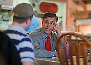 Congressman-elect Robert Schilling (IL-17) talks with his son and campaign manager Terry Schilling at his pizza shop, Saint Giuseppe's Heavenly Pizza, in Moline, Illinois on Tuesday November 9, 2010.