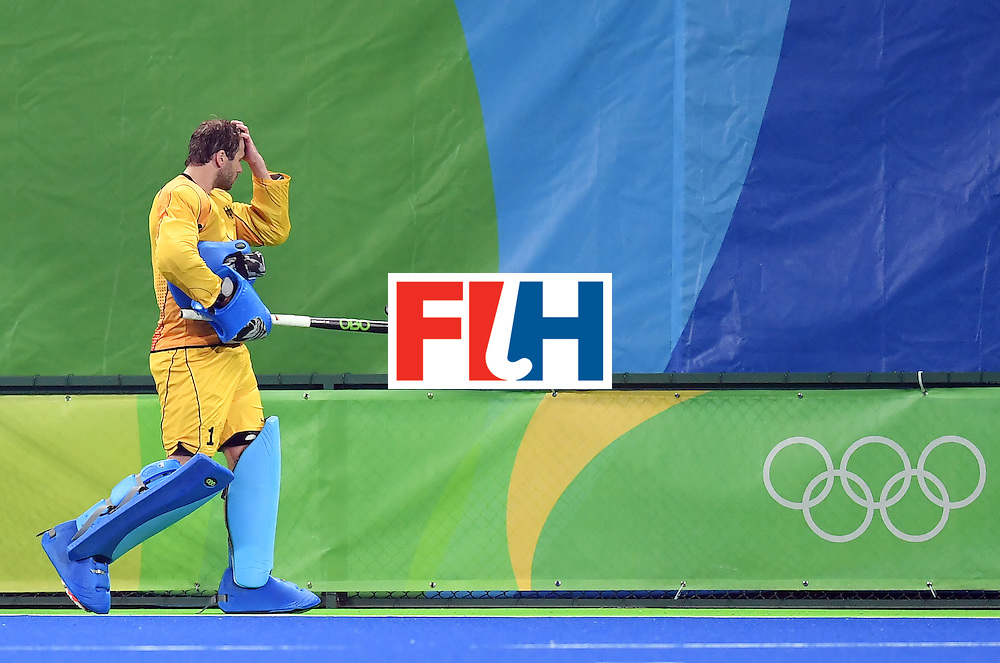 CORRECTION - Germany's Nicolas Jacobi leaves the pitch during the men's quarterfinal field hockey Germany vs New Zealand match of the Rio 2016 Olympics Games at the Olympic Hockey Centre in Rio de Janeiro on August 14, 2016. / AFP / MANAN VATSYAYANA / The erroneous mention[s] appearing in the metadata of this photo by MANAN VATSYAYANA has been modified in AFP systems in the following manner: [leaves the pitch during ] instead of [leaves the pitch at the end of]. Please immediately remove the erroneous mention[s] from all your online services and delete it (them) from your servers. If you have been authorized by AFP to distribute it (them) to third parties, please ensure that the same actions are carried out by them. Failure to promptly comply with these instructions will entail liability on your part for any continued or post notification usage. Therefore we thank you very much for all your attention and prompt action. We are sorry for the inconvenience this notification may cause and remain at your disposal for any further information you may require.        (Photo credit should read MANAN VATSYAYANA/AFP/Getty Images)