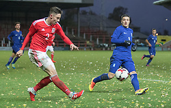 WREXHAM, WALES - Thursday, November 10, 2016: Wales' Cameron Coxe in action against Alexandros Katranis of Greece during the UEFA European Under-19 Championship Qualifying Round Group 6 match at the Racecourse Ground. (Pic by Gavin Trafford/Propaganda)