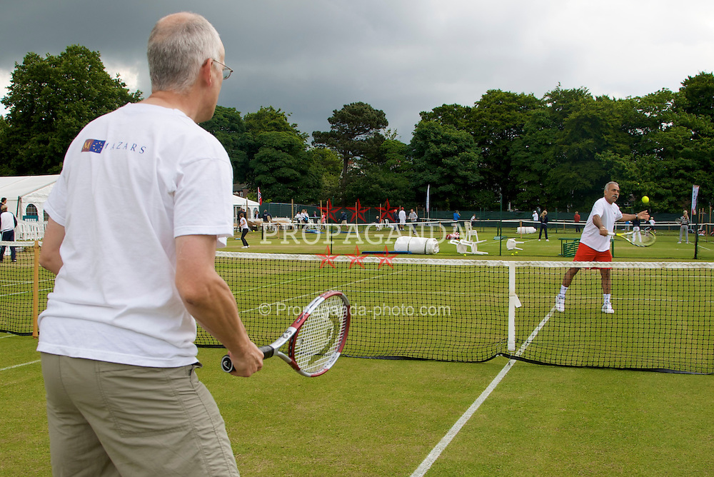 LIVERPOOL, ENGLAND - Thursday, June 12, 2008: xxxx with Mansour Bahrami during a Pro-Am session on Day Three of the Tradition-ICAP Liverpool International Tennis Tournament at Calderstones Park. (Photo by David Rawcliffe/Propaganda)
