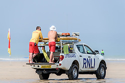 RNLI Lifeguards on duty at Fistral Beach in Newquay, Cornwall.