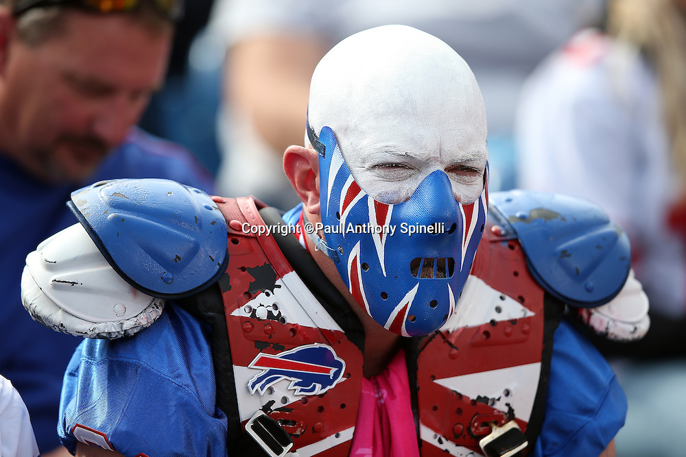 A Buffalo Bills fan wears a scary face mask, white paint on his bald head and face, and a set of shoulder pads during the Buffalo Bills 2015 NFL week 4 regular season football game against the New York Giants on Sunday, Oct. 4, 2015 in Orchard Park, N.Y. The Giants won the game 24-10. (©Paul Anthony Spinelli)