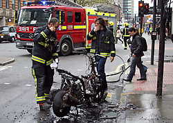 "© under license to London News Pictures. 15/04/11. John Mathers was on his way to work when his Gilera motorbike went up in flames on Tottenham court road this morning. Thick black smoke could be seen bellowing from the scene. One appliance from London Fire Brigades nearby Euston attended extinguishing the fire very quickly..Mr Mathers said ""I was going to cycle in this morning, but decided to take the bike (motorbike)"" adding ""I didn't know the bike was on fire untill someone pointed out that it was"". Thankfully no one was hurt or injured, but the motorbike is a write off, Fire-fighters commented motorbike fires are becoming more common within London. Picture credit should read Simon Lamrock/LNP"
