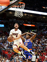 October 24, 2018 - Miami, FL, USA - The Miami Heat's Tyler Johnson, left, drives under the basket past the New York Knicks' Frank Ntilikina trying to avoid the foul in the first half on Wednesday, Oct. 24, 2018, at the American Airlines Arena in Miami. The Heat won, 110-88. (Credit Image: © Carl Juste/Miami Herald/TNS via ZUMA Wire)