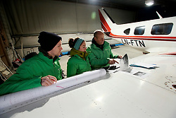 NORWAY BARENTS SEA 6DEC15 - Greenpeace campaigners Larissa Baeumer, Christian Bussau of Germany and Erlend Tellnes (L) of Norway prepare for the surveys flight to the production platform Goliat in the Barents Sea operated by Italian energy compay Eni. It is the world's most northerly oil production platform.<br /> <br /> jre/Photo by Jiri Rezac / Greenpeace<br /> <br /> © Jiri Rezac 2015