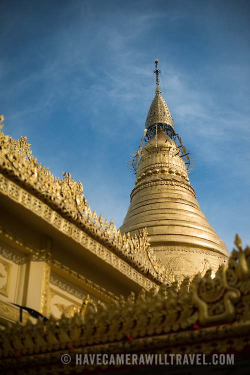 A gold-lined umbrella on top of Soon Oo Pon Nya Shin Pagoda. Sitting on top of Nga-pha Hill, Soon Oo Pon Nya Shin Pagoda is one of multiple pagodas and temples in the religious district of Sagaing, near Mandalay. The original pagoda dates to 674.
