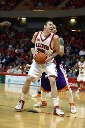 30 January 2007: Levi Dyer backs into the lane against Bradley Strickland. The Purple Aces of Evansville folded the final 2 minutes of play and handed the game to Illinois State University Redbirds by a score of 65-61at Redbird Arena in Normal Illinois.