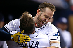 September 29, 2017 - St. Petersburg, Florida, U.S. - WILL VRAGOVIC   |   Times.Tampa Bay Rays third baseman Evan Longoria (3) gets a hug from right fielder Steven Souza Jr. (20) after his solo home run, his 20th for the season, in the fifth inning of the game between the Baltimore Orioles and the Tampa Bay Rays at Tropicana Field in St. Petersburg, Fla. on Friday, Sept. 29, 2017. (Credit Image: © Will Vragovic/Tampa Bay Times via ZUMA Wire)