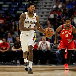Oct 11, 2018; New Orleans, LA, USA; New Orleans Pelicans guard Elfrid Payton (4) against the Toronto Raptors during the first half at the Smoothie King Center. Mandatory Credit: Derick E. Hingle-USA TODAY Sports