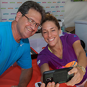 August 19, 2014, New Haven, CT:<br /> Andrea Petkovic poses for a selfie photograph as she signs autographs on day five of the 2014 Connecticut Open at the Yale University Tennis Center in New Haven, Connecticut Tuesday, August 19, 2014.<br /> (Photo by Billie Weiss/Connecticut Open)