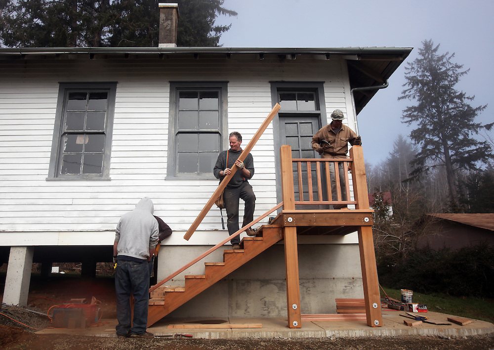 Clatsop Community College Historic Preservation students, under the supervision of their instructor Lucien Swerdloff and contractor Tim Kennedy, build staircases and railings during a workshop to replace the rotted porches on the historic U.S. Columbia River Quarantine Hospital (aka the Pesthouse) in Knappton Cove, Wash., on Sunday, March 6, 2011.