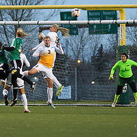 5th year defender Racquel Marshall (15) and 5th year defender Kayla McDonald (3)of  the Regina Cougars in action during the Women's Soccer home game on October 7 at U of R Field. Credit: Arthur Ward/Arthur Images